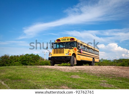 school bus against the dark blue sky - stock photo