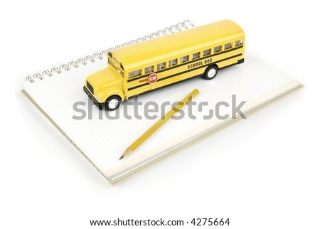 school bus and notebook with pen isolated on white background - stock photo