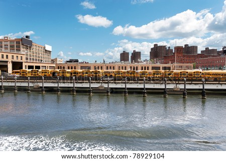 School bus depot by the East River, New York - stock photo