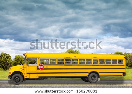 School Bus on american country road in the morning - stock photo