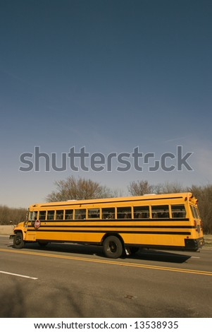 School Bus on the road - stock photo