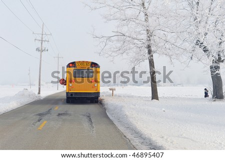 School bus on winter morning in rural area. - stock photo