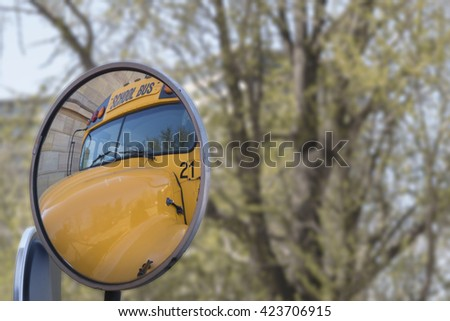 School bus seen through a mirror