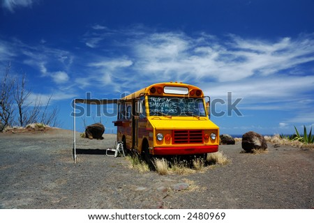 School Bus Used as Concession Stand On North Shore of Maui - stock photo