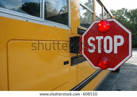 School bus with stop sign - stock photo