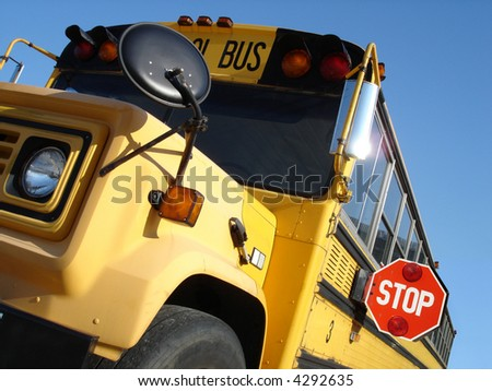 School bus with Stop sign out - stock photo