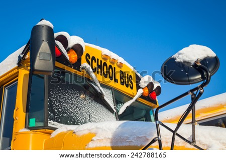 School buses after a fresh snowfall - stock photo