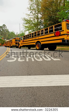 School Buses In a Line - stock photo