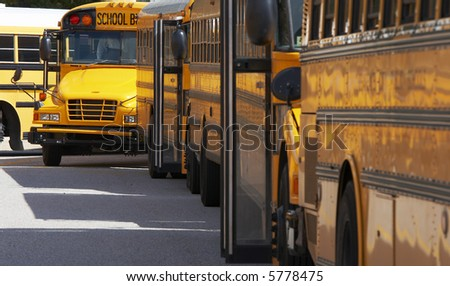 school buses in a row - stock photo