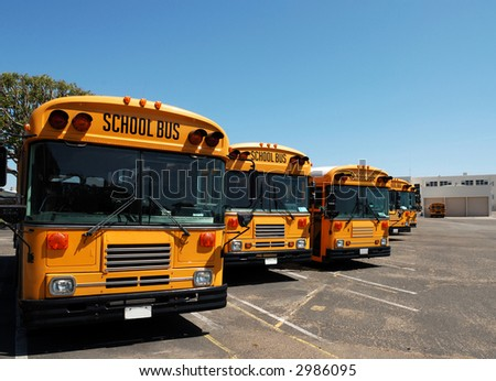 School Buses Lined Up and Parked For The Weekend - stock photo