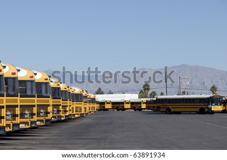 School buses waiting for deployment - stock photo