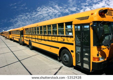 School buses waiting for students - stock photo