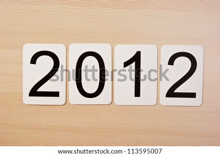 School card with new year 2012  on the table