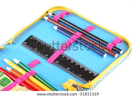 School case with a set of handles of pencils and a black ruler. - stock photo