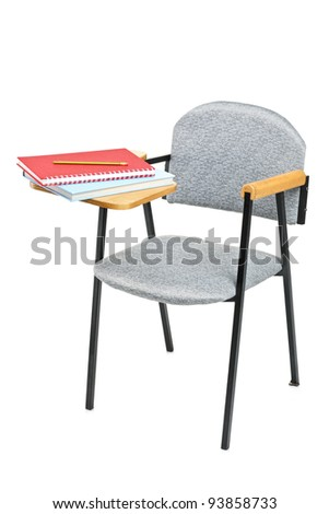 School chair with books on it, isolated on white background - stock photo