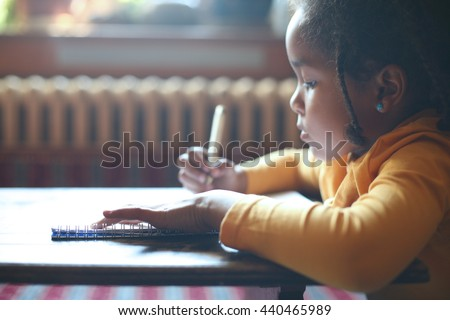 School child. African girl writing in notebook.  - stock photo