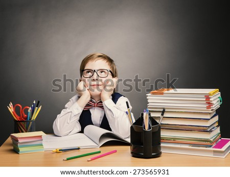 School Child Boy in Glasses Think in Classroom, Kid Primary Students Reading Book, Excellent Pupil Learn Lesson and Dream, Education Concept - stock photo