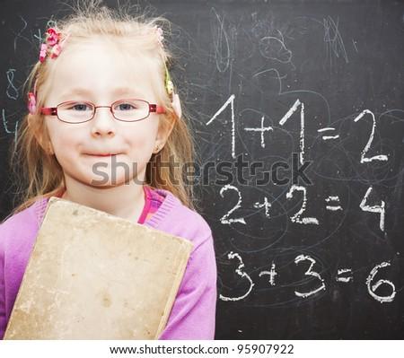 school child near blackboard See my portfolio for more - stock photo