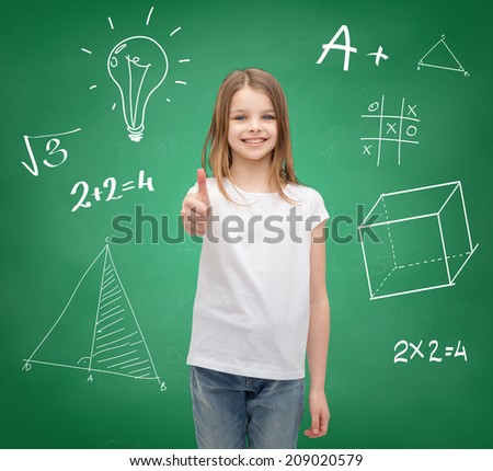school, childhood, gesture and education concept - smiling little girl in white blank t-shirt showing thumbs up - stock photo