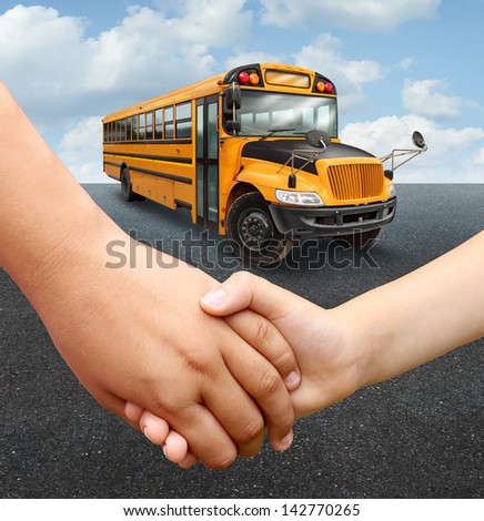 School children bus with two young students of elementary age holding hands preparing to go into the yellow transport vehicle as an education and learning concept. - stock photo