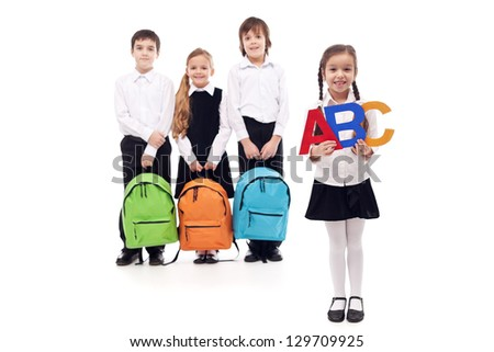 School children from elementary school - isolated with a bit of shadow - stock photo