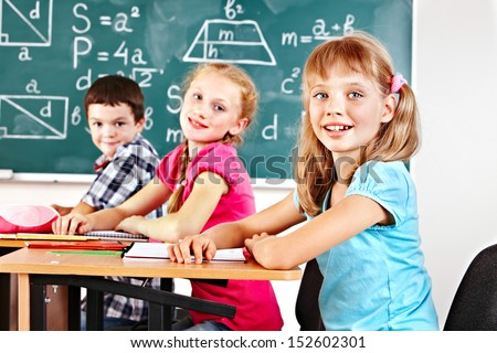School children girl and boy in classroom. - stock photo
