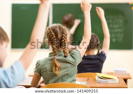 School children in classroom at lesson - stock photo