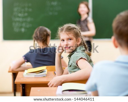 School children in classroom at lesson - stock photo