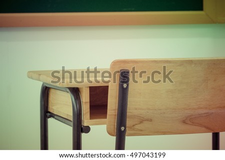 School classroom with desks wood, chalkboard and whiteboard in high school, vintage style