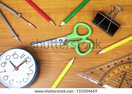 school composition, clock, pencils, calculator, measure equipment, and scissors - stock photo