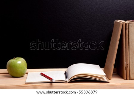 School concept, educational equipments, ruler, board and apple.
