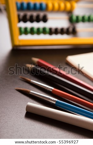 School concept, educational equipments, ruler, board and apple. - stock photo
