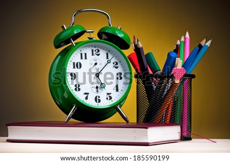 School concept - school accessories on dark yellow background - stock photo