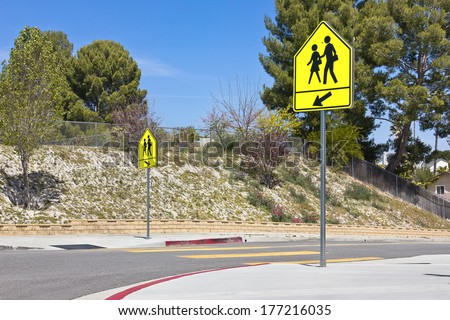 School crossing signs in a residential community.   - stock photo