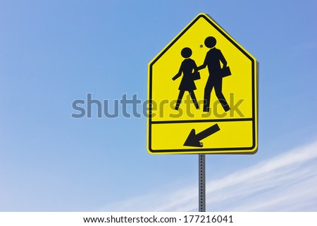 School crosswalk and arrow sign.  - stock photo
