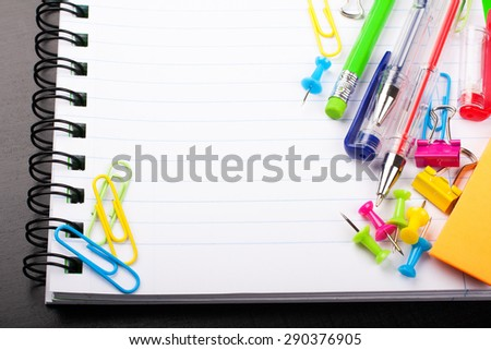 School education background with blank exercise book with copy space. Back to school concept.  Selective focus. - stock photo