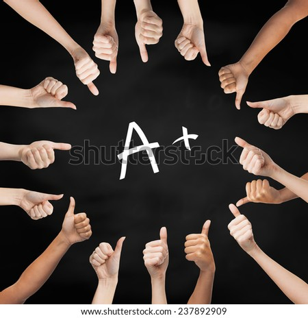 school, education, gesture and people concept - human hands showing thumbs up in circle over black board background with a mark - stock photo