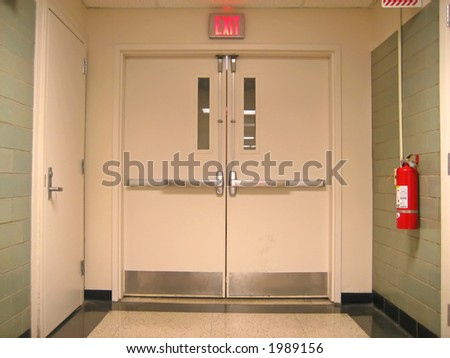 School Emergency Exit with Exit Sign and Fire Extinguisher. - stock photo