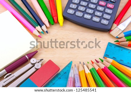 School equipment on writing desk - stock photo