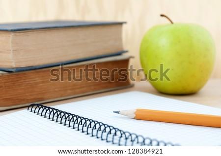 School equipment with apple - stock photo