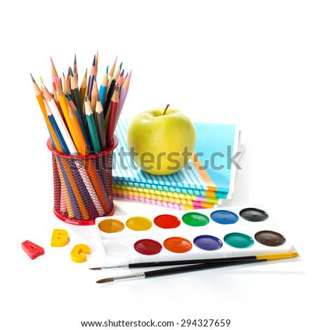 School equipment   with pencils, paints , brushes and apple isolated on white. Back to school concept. - stock photo