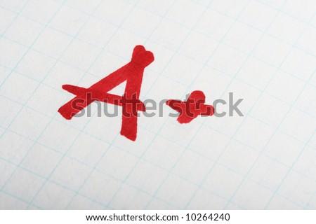 School exam grade A+ mark on paper - stock photo