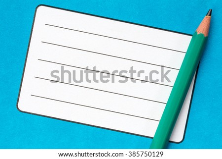 School exercise book with empty name label and pencil