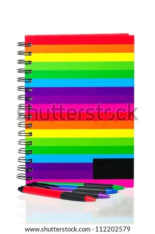 School exercise-book with pens on white background