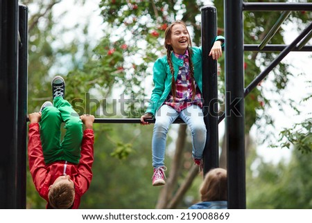School friends spending after-school time on sport facilities - stock photo