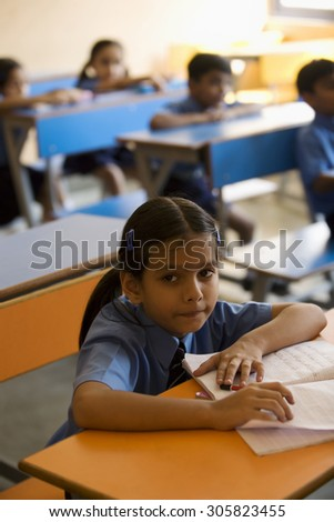 School girl at her desk - stock photo