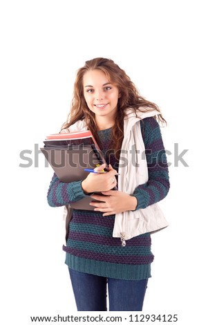 School girl holding books and smiling - stock photo