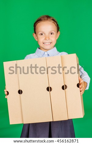 school girl in a school uniform with folder or box. Learning and school concept. Image on chromakey background. - stock photo