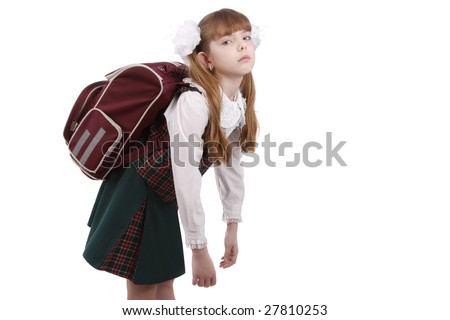 School girl is tired. Schoolgirl in school uniform with backpack. Pupil's satchel is very heavy.  Sad teenager. A heavy load to bear. Isolated on white in studio. - stock photo