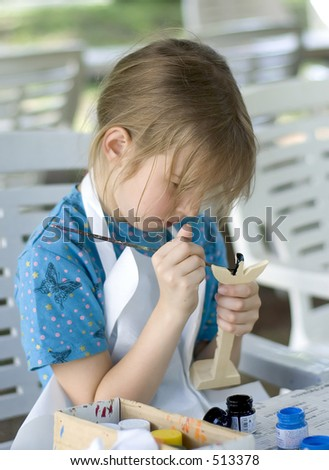 School girl painting totem - stock photo